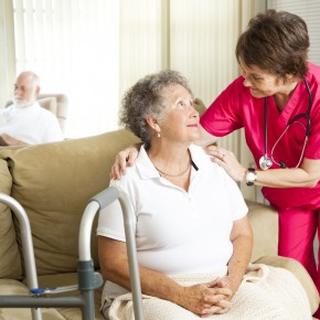 nurse tending to patient from the perspective of a toledo nursing home negligence attorney