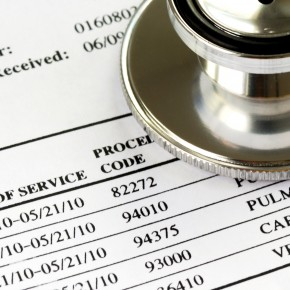 medical bills on the desk of toledo medical payments coverage lawyers