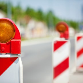road construction signs outside the office of toledo motor vehicle accident attorneys