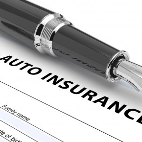automobile insurance policy on the desk of toledo insurance claims lawyer