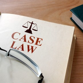 case law book and glasses on the desk of a toledo personal injury case lawyer