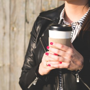 woman with coffee starting lawsuit with the help of toledo personal injury attorneys