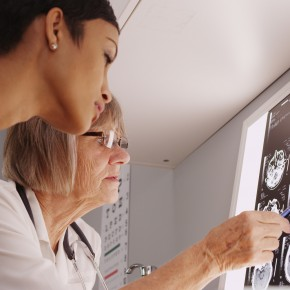 doctor and patient examining xray of brain before consulting with toledo brain injury lawyers