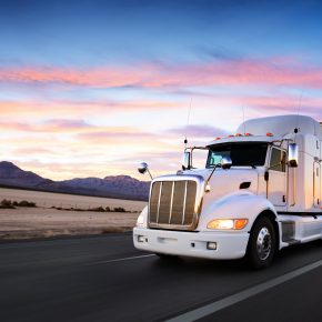 Truck and highway at sunset - transportation background for truck accident attorneys Toledo
