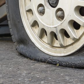 damaged flat tire belonging to someone calling a truck accident lawyer toledo