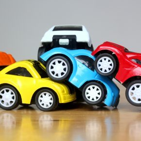 Car Accident concept image with colorful miniature cars for Toledo car crash lawyers