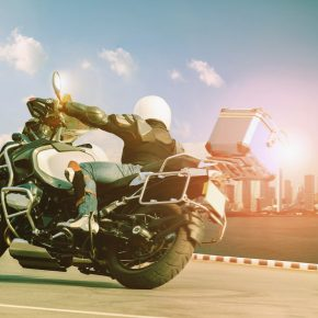 Male riding a motorcycle on a sharp curve, and if you need a lawyer for a motorcycle accident, call a Toledo Motorcycle Accident Attorney.