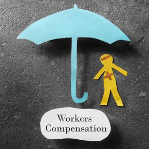 paper image of man and umbrella with the message workers compensation which Toledo Ohio Workers Comp Attorney can assist