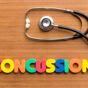 Concussion written with colorful magnets and if you need a top brain injury attorney in Maumee, Ohio.