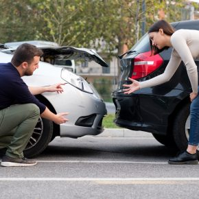 People examining car body damages after rear end collision and if you need a skilled rear end collision accident attorney you will find one in Maumee.