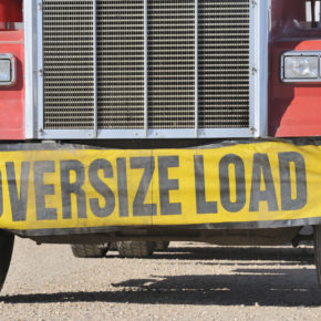 Closeup of oversize load sign on front of truck and if you have been injured in a truck accident find a good attorney to represent you in Toledo.