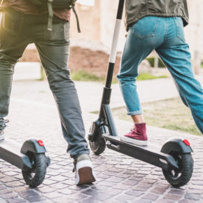 two men on scooters representing how our Cleveland personal injury lawyers can help with e-scooter lawsuits