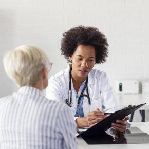 A Doctor talking to a patient, representing how one should seek out for her from a Toledo medical malpractice attorney.
