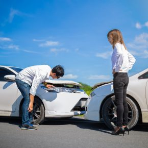 Two drivers inspect their cars before calling a personal injury attorney in Ohio.