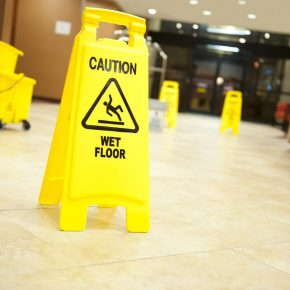 Caution sign on the floor of a lobby representing how an Ohio personal injury lawyer can help you with your case.